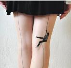 model stocking climbing up tights